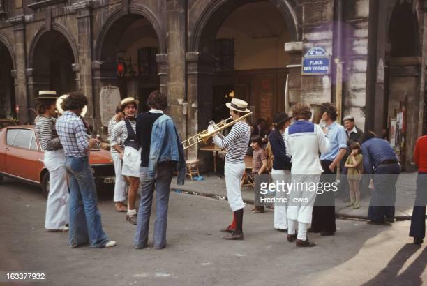 Street musicians in Place des Vosges Le Marais Paris France 1975