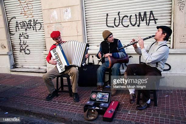 Street musicians performing at Sunday San Telmo market, Avenida Defensa.