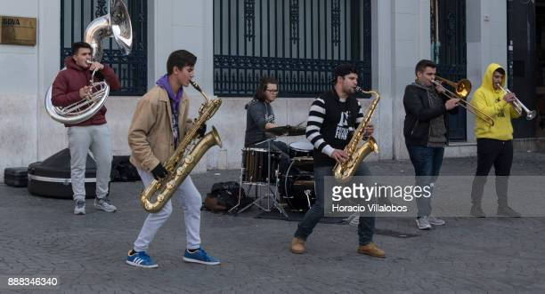Street musicians play jazz for tourists in Praca da Liberdade during the visit to the city by participants of Gastronomic FAM Tour on December 01...