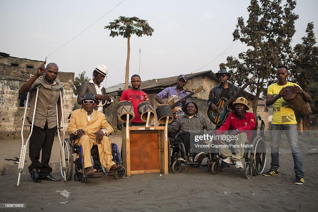 Street musicians Staff Benda Bilili are photographed for Paris Match on August 27, 2013 in Kinshasa, Democratic Republic of Congo.