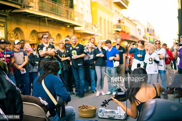 Street musicians Tanya and Dorise performing on Royal Street in the French Quarter in front of an audience during Super Bowl week in New Orleans