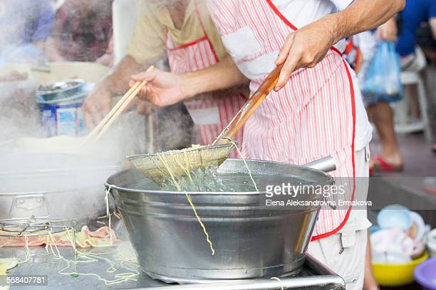 street noodle stall in georgetown, penang - george town penang stock photos and pictures