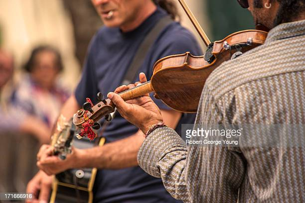 street nusicians in lisbon portugal - busker stock pictures, royalty-free photos & images