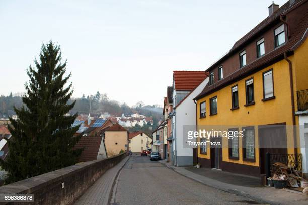 Street of a small old town Europe, Germany. Solar panels on old tiled roofs