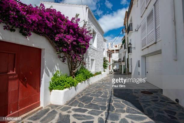 street of cadaques, a small town on the costa brava, spain - town fotografías e imágenes de stock