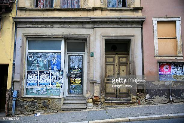 Street of derelict houses in Zeitz Sachsen Anhalt Germany Rahne Strasse empty abandoned house front and empty derelict shop front