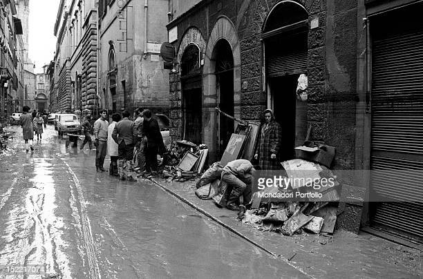 A street of Florence flooded by mud and full of piles of rubble after the inundation Florence 1966