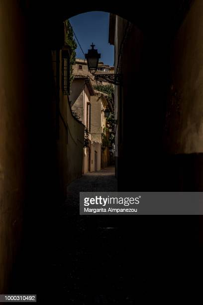 Street of Granada framed through the silhouette of an arch