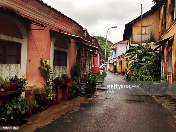 street of panjim (goa) in a rainy season - panjim stock photos and pictures