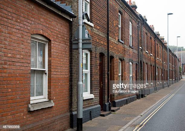 Street of red brick nineteenth century terraced housing in the town of Cromer north Norfolk England