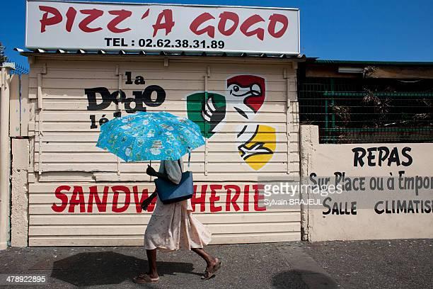 CONTENT] A street of Saint Paul Reunion Island Indian Ocean France