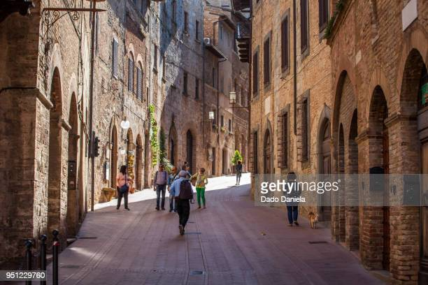 street of san gimignano - volterra stock photos and pictures
