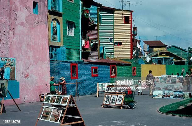 A street of the barrio La Boca in Buenos Aires the old italian neighborhood of the Argentina's capital with its walls and dwellings painted in...