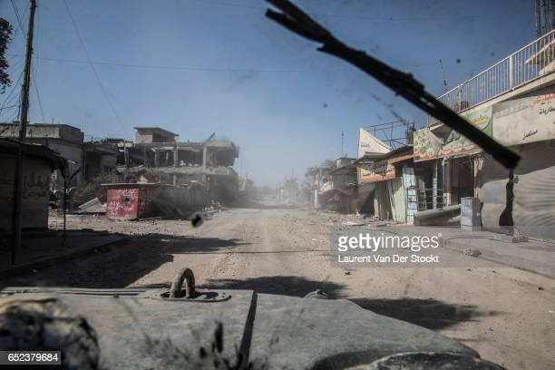 Street of the center of western Mosul, taken back from IS by the emergency response division , is seen from their Humvee's armored windshield.