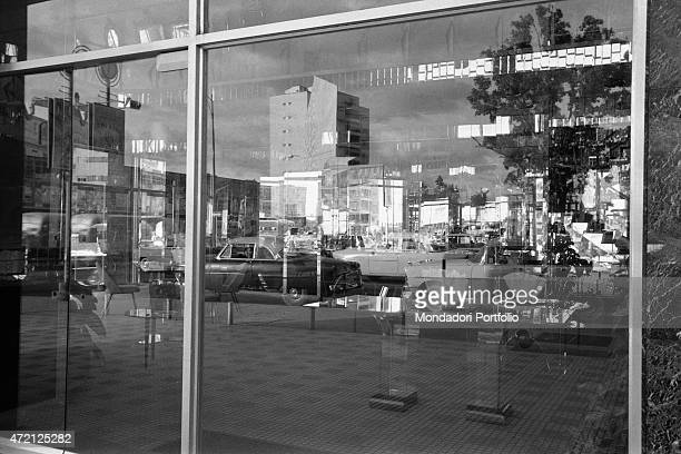 'A street of the city reflected by a shop window Caracas January 1958 '