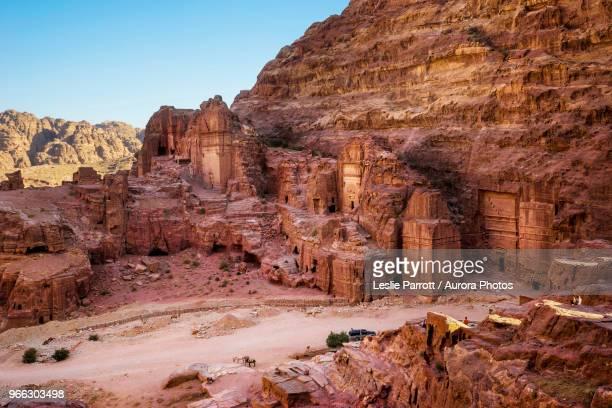 street of tombs and temple facades, including uneishu tomb, in petra, wadi musa, maan governorate, jordan - petra jordan stock pictures, royalty-free photos & images