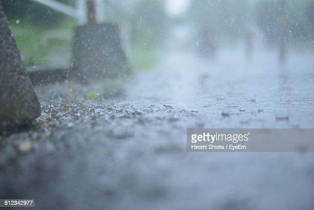 street on rainy day - heavy rain stock photos and pictures