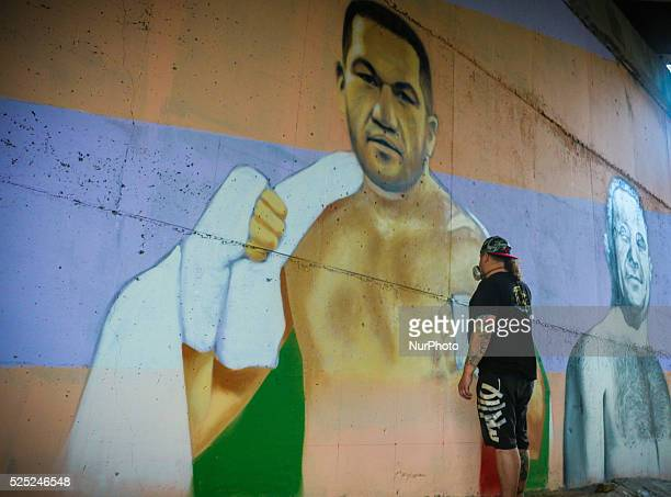 A street painter draws the portrait of the famous bulgarian boxer Kubrat Pulev Kobrata in support of his fight against the professional heavyweight...