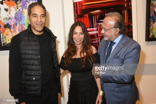 Street Painter JonOne a guest and Olivier Dassault attend JonOne Paintings Exhibition Preview Hosted by Natacha Dassault and Olivier Dassault at Not...
