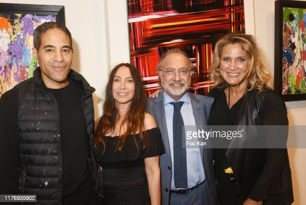 Street Painter JonOne a guest Olivier Dassault and Not A Gallery director Natacha Dassault attend JonOne Paintings Exhibition Preview Hosted by...