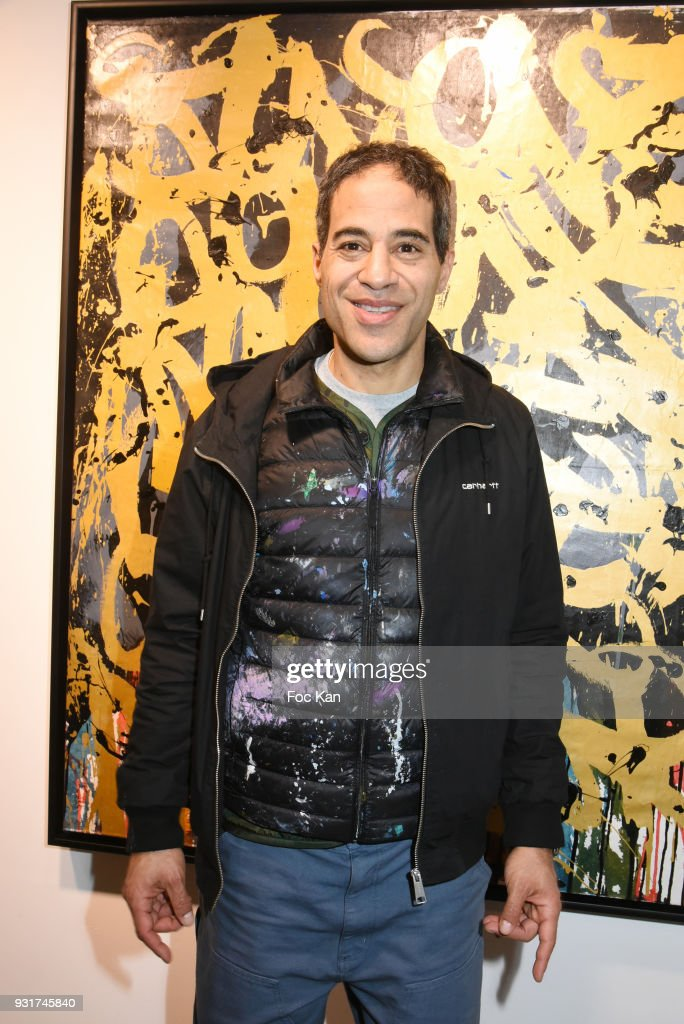 Street Painter JonOne poses with hiswork during ÕBirth of The WindÕ JonOne PreviewÊat Galerie Brugier Rigail on March 13, 2018 in Paris, France.