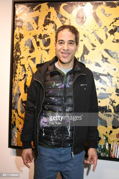 Street Painter JonOne poses with hiswork during ÕBirth of The WindÕ JonOne PreviewÊat Galerie Brugier Rigail on March 13 2018 in Paris France