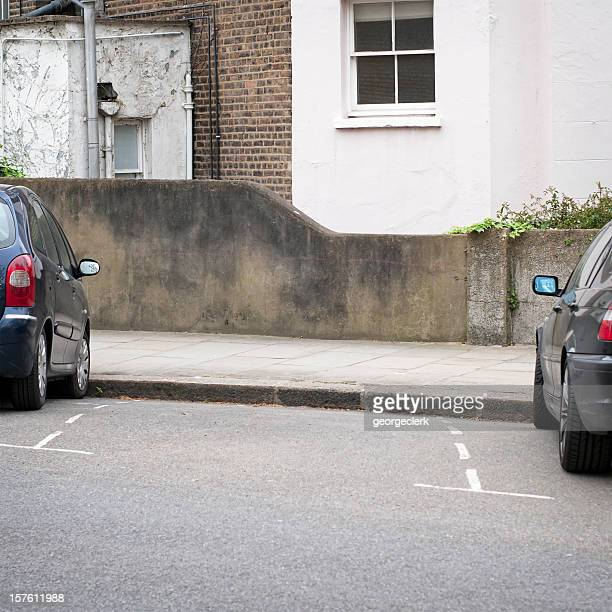 street parking space - curb stock pictures, royalty-free photos & images