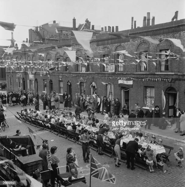 A street party at Morpeth Street in London's East End to celebrate the coronation of Queen Elizabeth II Picture post photographer Thurston Hopkins is...