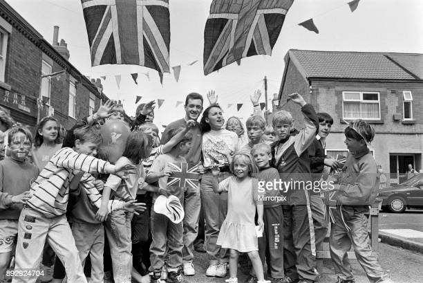 A street party held for British cyclist Chris Boardman following his return home from the 1992 Olympic Games in Barcelona where he won a gold medal...
