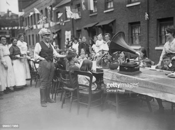 Street party in the East End of London to celebrate the Treaty of Versailles and the end of the First World War, July 1919.