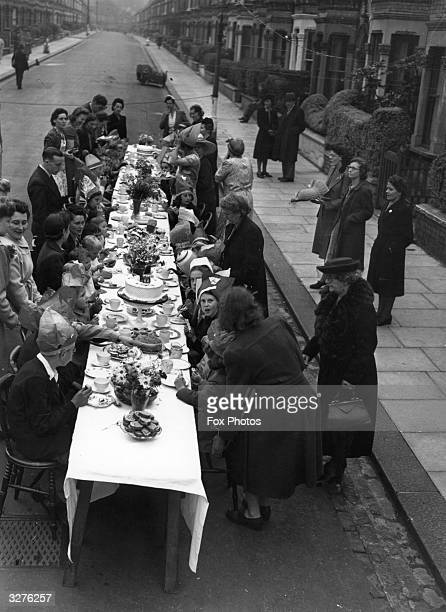 A street party near Clapham Common London to celebrate Victory in Europe in the final months of World War II 8th May 1945