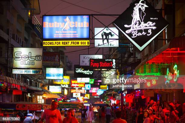 street pattaya soi 6 with bars - red light district stock photos and pictures