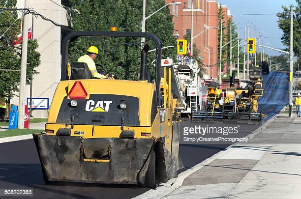 street paving crew - asphalt paving stock photos and pictures