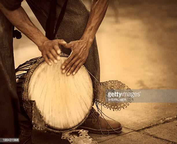 street percussionist playing african drum