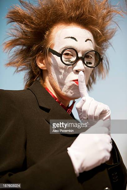 a street performance called a mime wearing a glasses - happy clown faces stock photos and pictures