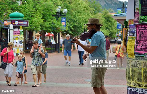 street performer at historic pearl street mall in boulder colorado - boulder colorado stock photos and pictures