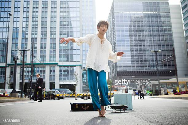 Street performer dancing in the financial  area