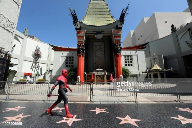 HOLLYWOOD CA JULY 28 2020 A street performer dressed as SpiderMan looks for customers to pose for photos on a deserted section of Hollywoods Walk of...