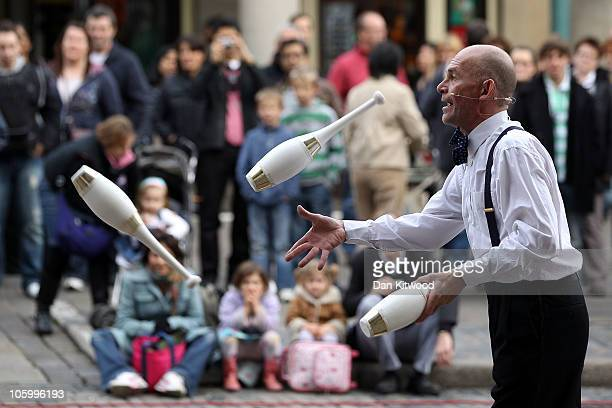 A street performer entertains members of the public in Covent Garden in central London on October 23 2010 in London England The World famous Covent...