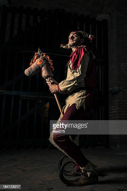 street performer jester with horse puppet - joker card stock photos and pictures