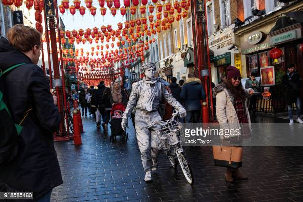 A street performer makes his way through Chinatown ahead of Chinese New Year tomorrow on February 15 2018 in London England Chinese New Year The Year...