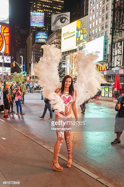 """street performer """"naked girl"""" at times square - times square body paint stock pictures, royalty-free photos & images"""