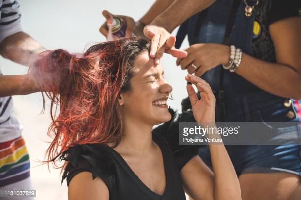 street performer painting hair - hair colourant stock pictures, royalty-free photos & images