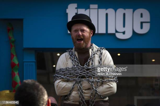 Street performer stages a show on The Royal Mile in Edinburgh, Scotland on April 11, 2019. - With Britain tearing its hair out over the Brexit...