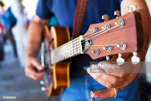 street performer tuning - country and western music stock pictures, royalty-free photos & images