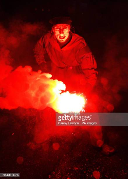 A street performer with a flare takes part in the 'The Night Afore Monster Ceilidh' part of the Edinburgh Hogmanay celebrations on George Street