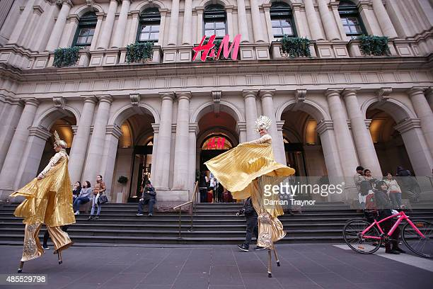 Street performers are seen during Vogue Fashion's Night Out on August 28 2015 in Melbourne Australia