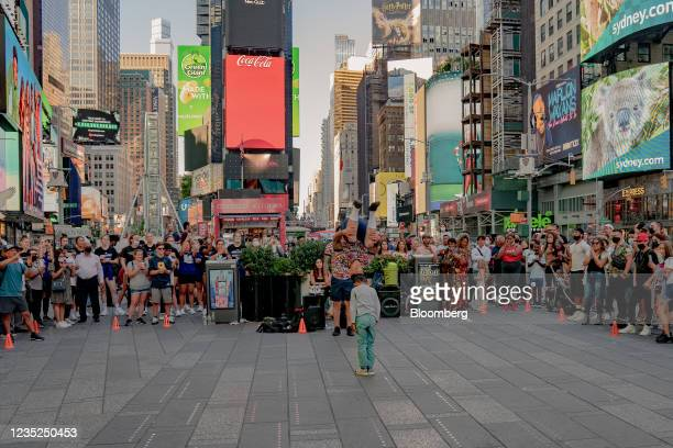 Street performers dance in the Times Square neighborhood of New York, U.S., on Saturday, Sept. 4, 2021. This month, as Broadway theaters, Lincoln...