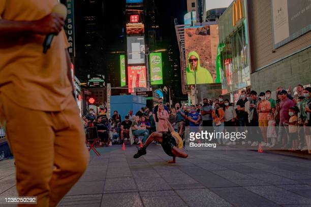 Street performers dances in the Times Square neighborhood of New York, U.S., on Saturday, Sept. 4, 2021. This month, as Broadway theaters, Lincoln...