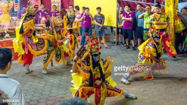 street performers dress up to imitate the ghost and gods during hungry ghost festival - hungry ghost festivals in malaysia foto e immagini stock